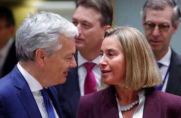 Belgian Foreign Minister Reynders and EU Foreign Policy chief Federica Mogherini attend a European Union foreign ministers' meeting in Brussels