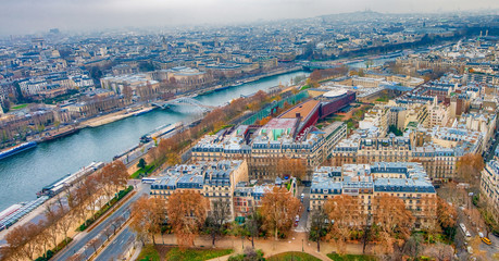 Fototapete - Paris aerial skyline with Seine river on a cloudy winter day, Fr