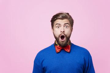 Portrait of shocked man at studio shot .