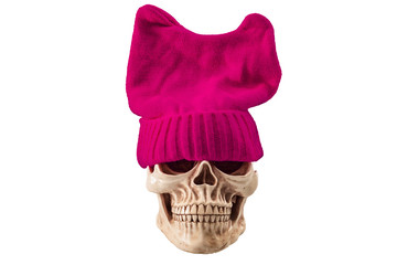 Tough and scary liberal feminist concept with a skull wearing a pink pussy hat isolated on white clipping path
