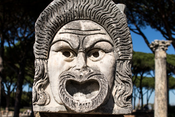 Marble Mask decoration in Ostia Antica theatre. Ancient Rome 1st century mask in the proscenium of Ostia antica, part of architectonic decoration