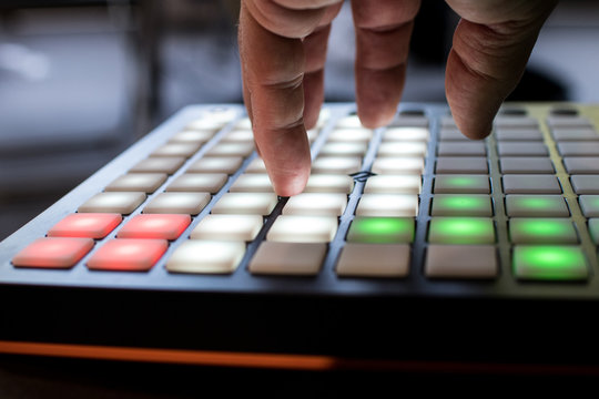 musical instrument for electronic music with a matrix of 64 keys in 8 x 8 files..Pad for music with buttons illuminated by white, red and greem like italian flag