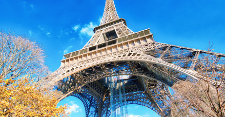 Upward view of Eiffel Tower on a beautiful sunny winter day - Paris - France