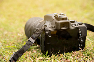 Close up Camera DSLR on green grass floor