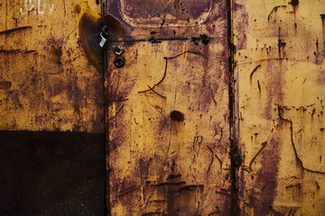 metallic yellow rusty door