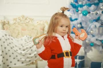 New year small boy at Christmas tree.