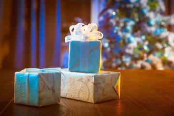 New Year's gifts wrapped in blue paper.