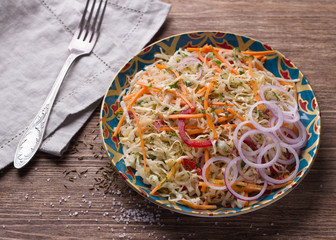 Cabbage salad with carrots, red pepper, onions, cilantro and spices