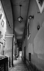 Typical passage in the historical center of Modena, Italy
