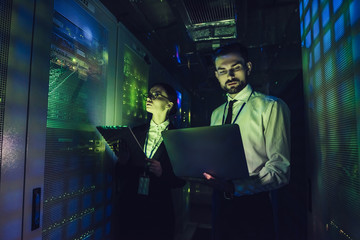 Man and woman in data centre