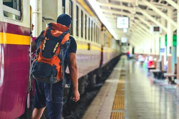 Man with backpackwaiting to travel by train