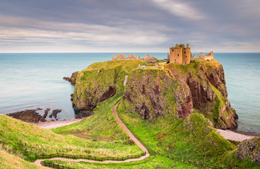 Dunnottar Castle Headland / Dunnottar Castle is a ruined medieval fortress located upon a rocky headland on the north east coast of Scotland, near Stonehaven Wall mural