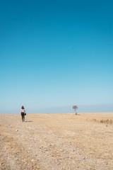 Back view of woman walking on field