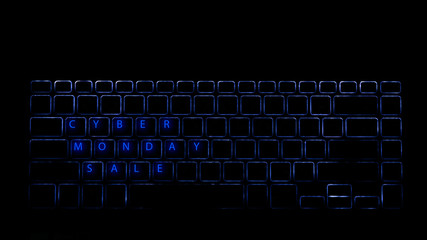 Crop shot from above of keyboard with glowing letters saying Cyber Monday Sale