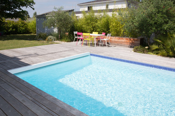 cheerful pool in home house garden in summer