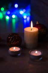 Decoration for Christmas and New Year. Xmas day. Candles and shining decorations.