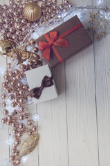 Christmas boxes on wooden background, roses and balls, happy sunny day