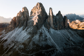 Aerial of the famous dolomites Tre Cime in Italy during sunset