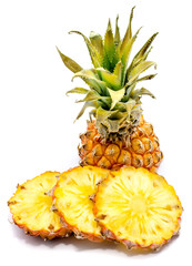 Fresh sliced pineapple with green leaves isolated on white background.