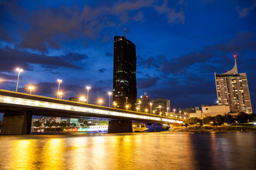 Vienna skyline on the Danube river at night