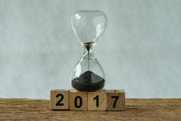 Year end 2017 business time countdown or improvement review concept as hourglass or sandglass with wooden cube block number 2017 Fotomurales