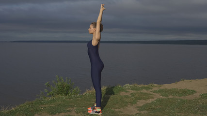 Yoga woman in sportswear, energy concentration