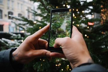 Taking photo of beautiful Christmas tree