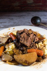 beef stew on plate in rustic setting