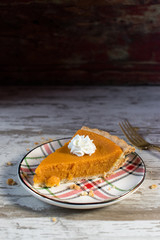 sweet potato or pumpkin pie slice with whipped cream