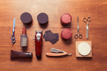 Top view of vintage barbershop tools on wooden background, flat lay overhead view