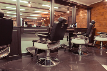 Stylish vintage retro interior with barber shop chair. Barbershop background theme
