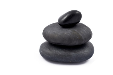 Massage stones stock images. Black stones on a white background. Massage stones for relaxation