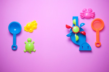 Top view of plastic sand toy on pink background
