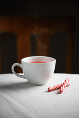 White mug of peppermint tea on a table.