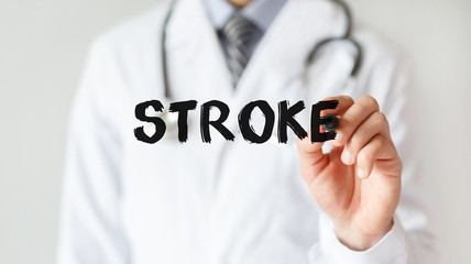 Doctor writing word Stroke with marker, Medical concept