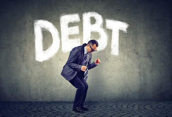 Stressed business man under debt pressure