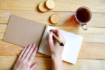 The girl writes in a notebook