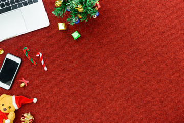 Top view computer and phone for business concept with Christmas festival theme background.