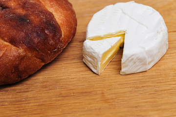 Bread with chees camembert on wood table