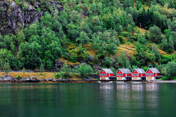 Reflection of a small houses in norwegian fiord, Norway