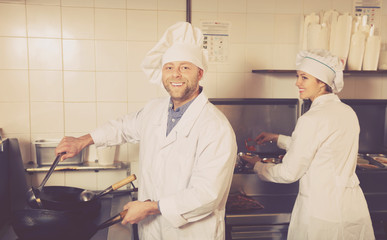 Chef and his helper at bistro kitchen