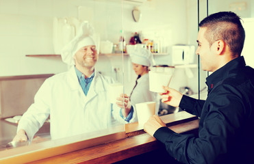 client buying take-away food