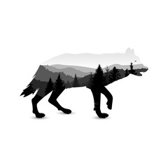 Silhouette of wolf with mountain landscape. Grey tones.