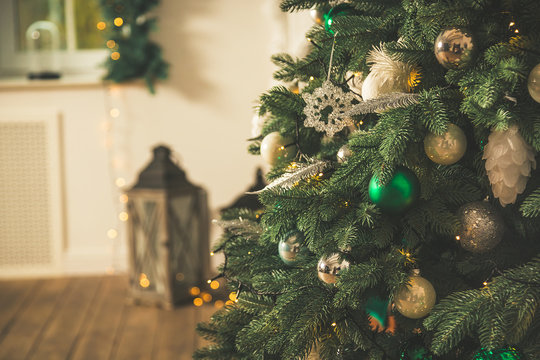 Christmas tree in Christmas living room. Beautiful New Year decorated classic home interior. Winter background