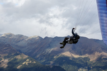 Paraglider flying over the Alps mountains. Goldeck ski resort, Carinthia, Austria.