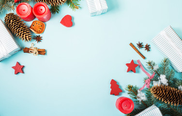 Christmas background with decorations and gift boxes on blue board with copy space