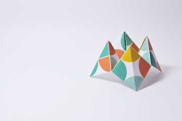 colorful origami fortune teller on white background