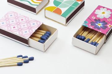 decorated matchboxes on white background