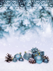 Christmas blue background with balls hanging on pine tree. Banner with copy space