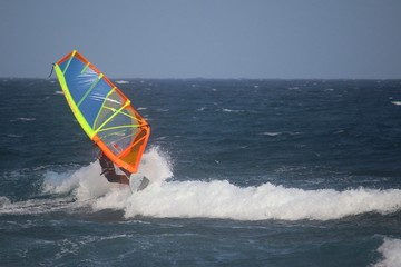 Windsurfer riding the waves of the atlantic ocean